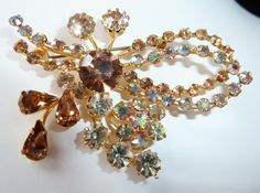 Austria Crysta Largel Rhinestone Pin    Beautiful large sparkling mixed crystals pin signed Made in Austria. Good quality stones...well set.