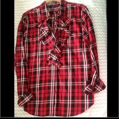 Plaid Ruffle Ralph Lauren Button Up This red plaid Ralph Lauren button up has adorable ruffle detail on the front. I purchased a large so it's long enough to wear with leggings and riding boots. Ralph Lauren Tops Button Down Shirts