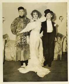 Before Bjork's swan dress there was Marlene Dietrich. Love Bjork, but Marlene did it better. Miss Marlene arrived at Basil Rathbone's costume party with Clifton Webb and Elizabeth Allen on each arm and an elegant swan gown draped across her body.    Oh...and the swan wasn't white,  each feather was dyed to match the pale blue of Marlene's eyes.