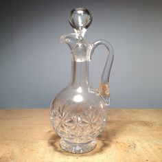 Vintage Cut Glass Decanter - 020  £38.00 This vintage cut glass decanter is the perfect way to bring the best out in your favourite drink.  Perfect as a gift or as a treat to yourself!  We always have a great range of vintage decanters in store, why not pop in and see the full collection!   Dimensions  Height 29cm, Length 14,5cm