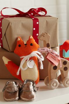 Whimsical Gifts. Let baby shower guests get playful with the theme by bringing out wooden toys, plush foxes and brown-paper packages tied with bows.