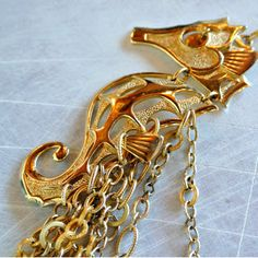 Shop Hey Lola - recycled seahorse necklace
