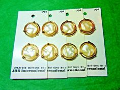 """(8) 7/8"""" JHB GOLD SURROUND WHITE PLASTIC SHANK BUTTONS 4-CARD LOT(N933)"""