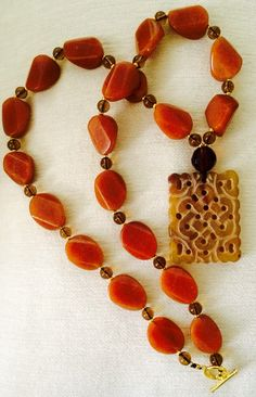 Jade pendant ( good luck charm) and Chinese orange agate.