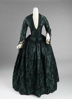 1850-55 American, green & black silk brocade, 2-psc evening dress with black lace trim.  Note the sleeves are smaller than later in the 1860's.