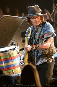 ee009b72a384 Actor Johnny Depp performs onstage during the 2012 MTV Movie Awards at  Gibson Amphitheatre on June 2012 in Universal City