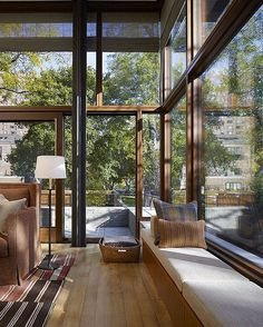 glass exterior walls with built-in window seat