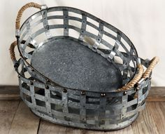 Just darn cool.  Could use these for lots of organizational needs...Galvanized Metal Baskets with Rope Handles (set of two)