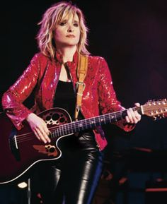 Melissa Etheridge. Can sing lullabyes to blues, classic, and all of her own songs and sound spectacular.