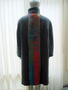 A woolen coat, very nice for the long and cold winter, redesigned with fabric from textile artist Anne van den Heuvel