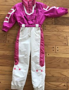 Wild Ski Jacket / Suit in Vivid Pink by Head. Love! Great, great color! Interior and exterior pockets. The front has zip and snap front closure. Such a very cool ski outfit. Size 12 but... But please refer to measurements!! -Approximate Measurements: Underarm to underarm- 21. The