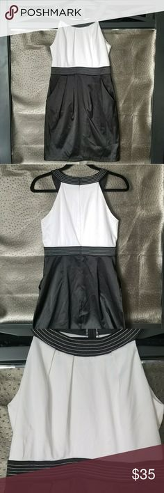B. Darlin CLASSIC BLACK & WHITE COCKTAIL DRESS Only worn once. Looks brand new! Love the two discrete pockets on the front!!! Stitching is perfect. *** I believe this is a JUNIOR'S 9/10.*** Fits like a true women's size 8. Extremely flattering fit. B. Darlin Dresses
