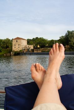My feet by a water mill on the River Lot
