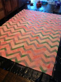 After looking at all the options for a chevron rug, THIS is the blog to go to.  Make your own!! cheap and if you ask me, looks much better!