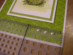 Do you ever have trouble getting your pearls or rhinestones spaced evenly? Here's a little trick - use your mat pack. The pearls and rhinestones fit perfectly inside the largest holes and you can get them lined up perfectly straight on your card. (Aug 25, 2011)