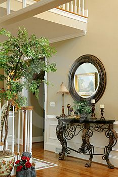 Foyer of Upscale Home. With half-moon shape furniture , Tuscan Decorating, Hallway Decorating, Entryway Decor, Interior Decorating, Foyer Furniture, Wrought Iron Decor, Entry Tables, Mediterranean Home Decor, Cheap Home Decor