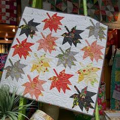 It's mini quilts like this that make you fall in love with Fall even more.🍁 Love this Moda.  #pineneedlesutah #showmethemoda #gardnervillage #fabric #miniquilt #quilt #quilts #quilting #sewing #sew #loveit #crafts #wednesday  #november #fall #fun #autumn #leaves #pumpkins #cozy