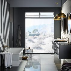 Drawing inspiration from scenic safaris, big graphic stripes are paired with glowing bronze highlights and a window on the desert world. #KohlerIdeas