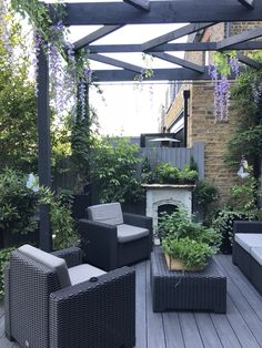 my outdoor patio deck area. bringing the inside out. outdoor fireplace, chevron pergola, herbs and . Deck With Pergola, Wooden Pergola, Pergola Shade, Pergola Patio, Pergola Plans, Pergola Kits, Backyard Landscaping, Pergola Ideas, Pergola Cover