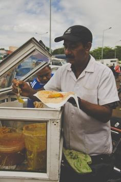 Sarah Duff recently came back from a foodie trip to Mauritius. Read about her experiences here. This is roti chaud from the back of a motorbike.