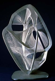 Naum Gabo - Linear Construction No. 4. Using wires to create complex curves around a rigid framework (steel and aluminum)