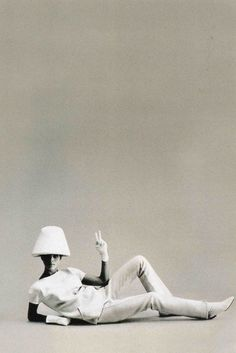 André Courreges - 1960s. Had the boots, without cutouts, and a copy coat from Wallis in linen/moygashel, which smelled of cat pee when it got wet