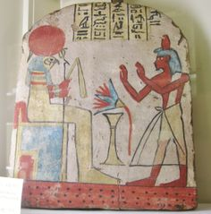 Painted wood funerary stele showing deceased adoring Horus. Dynasty XXII or later. Petrie Museum, University College, London