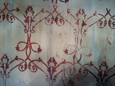 Paint the background of canvas.  Sponge stencil on to canvas.