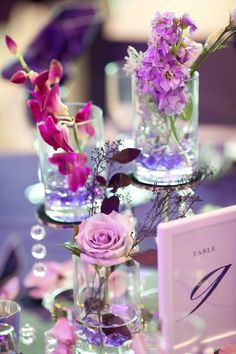 LOVE these centerpieces! Photo by Roee. #WeddingPlannersMN #WeddingCenterpieces
