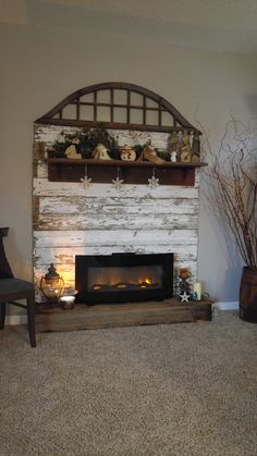 Ive been wanting one of those wall mounted electric fireplaces for a while now andwith Winter and the holidays right around the corner it seemed likethe perfect time to build my faux firep Pallet Fireplace, Wall Mounted Fireplace, Faux Fireplace Mantels, Farmhouse Fireplace, Fireplace Design, Fireplace Ideas, Fireplace Modern, Mantles, Cabin Fireplace