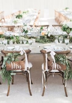 Mrs. + Mr. garland topped sweetheart chairs: http://www.stylemepretty.com/michigan-weddings/grand-rapids/2015/12/01/romantic-frederik-meijer-garden-wedding/ | Photography: Blaine Siesser Photography - http://blainesiesserphotography.com/