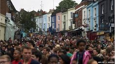 Crowds of people descend on Notting Hill Carnival as hundreds of youngsters taken part in the Children's Day procession. Notting Hill Carnival, Child Day, London England, Crowd, Past, Street View, Oxford, Reading, Past Tense