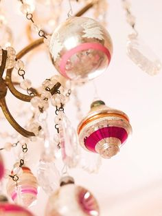Hang bulbs and other ornaments or garland from chandeliers and lights for Christmas :)