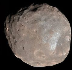 Phobos : Moon of Mars -  Phobos is the larger and closer of Mars' two satellites. It is 7.24 times more massive than the second satellite, Deimos. Its systematic designation is Mars I
