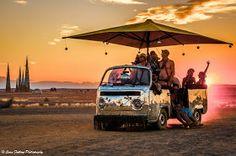 Sunset, disco-bus, umbrella, fun - Tankwa, South Africa. Sean Furlong Photography: AfrikaBurn 2014