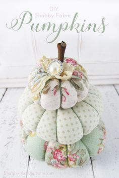 Turn an ordinary ladder into a Cottage Chic Masterpiece with just a little paint, floral paper or wallpaper plus Mod Podge.  Drop by Flamingo Toes and Bev will show you how simple it is.  Add your favorite treasures and voila! . . These Dream DIY Shabby Fabric Pumpkins should be in every Cottage Chic Home …