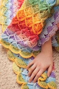 Mad Mad Me's Bavarian Crochet Blanket! Love the colors. The pattern is the crochet wheel stitch.   http://crochet-mania.blogspot.com/2009/06/crochet-wheel-stitch-square-catherines.html