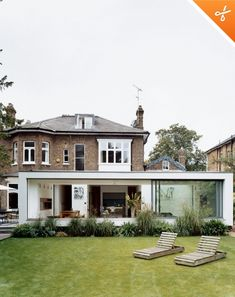 White rendered modern extension against brick house