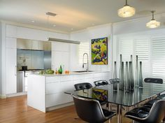 backpainted glass - pale grey. unifying effect/warmth of wood in kitchen and dining