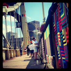Volunteer Sweat Shop Workers | 16 Instagrams From Pittsburgh's Knit The Bridge Project Install