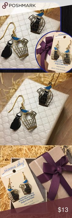 "NWT ""Cat in Birdcage"" earrings😻by Sienna Sky! 😻😻😻! Adorable, fun, whimsical, & lightweight! NWT ""Cat in Birdcage"" earrings, specially designed by CO artist Barbara MacCambridge for Sienna Sky. Very intricate, & kind of 3D?(subtle though!). Even better in person, IMO😀. Constructed w/ gold-filled, hook-style earwires that slip easily into ears. Approx 1.55"" long (including earwire) x 0.7"" wide. Comes with gift box. Note: Sienna Sky jewelry is etched from nickel silver, brass & copper, and…"