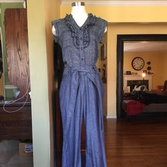 "Anthropologie jump suit Navy white polka dot upper portion with denim style pants. Strap tie belt at waist. Side pockets. One piece. 32"" inseam pants Anthropologie Pants"