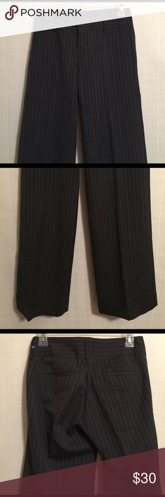 Banana republic factory store sz 0 pinstripe pants Banana Republic Factory Store Gray Pin Striped Dress Pants  Size: 0 Style:  Front zip with button and two hook and eye closure, flat front, no side pockets, two back envelope style pockets, and 2 inche cuffed hems Materials:  60% wool and 40% polyester.  Fully lined with 100% polyester  Measurements (approximate) Waist (laying flat): 14 inches Hips (laying flat):  17 inches Inseam: 31 inches Rise:  8 inches Leg Opening (laying flat):  11…