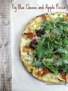Fig Blue Cheese and Apple Pizza - This pizza will so delicious you will make it again and again.  Topped with Blue Cheese, Aged Cheddar, Baby Kale, Prosciutto, Balsamic Marinated Figs and fresh Apple - a combination of flavours that is truly perfection.