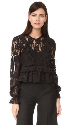 ¡Consigue este tipo de top corto de PREEN BY THORNTON BREGAZZI ahora! Haz clic para ver los detalles. Envíos gratis a toda España. Preen By Thornton Bregazzi Preen Line Emily Top: A Preen By Thornton Bregazzi crop top made from delicate lace. Ruffle trim and contrast ribbons add feminine flair. Buttoned keyhole. Long bishop sleeves. Optional camisole lining. Fabric: Lace. 100% cotton. Dry clean. Imported, India. Measurements Length: 19.75in / 50cm, from shoulder Measurements from size S…