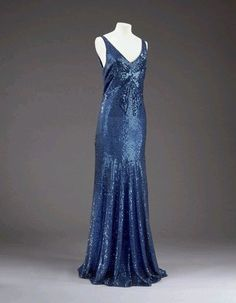 1932  Machine and hand sewn blue tulle and sequins.