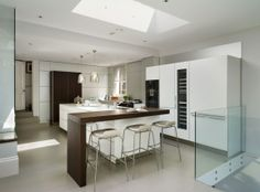 Black/brown oak and white - bulthaup by Kitchen Architecture
