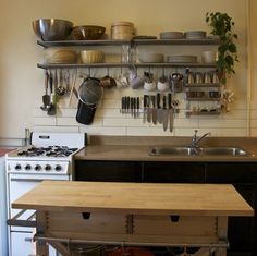 I love this - everything useful massed together. Not this specific look in my particular kitchen, but something like it. Hm.