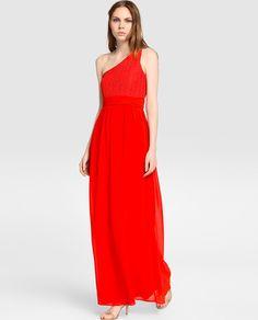 60€ rebajado Vestido largo de fiesta en color coral, con la parte superior asimétrica de encaje y la parte de la falda en gasa a tono. Detalle de cinturón ,efecto fajín.