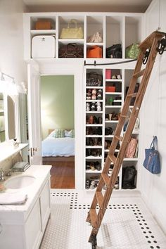 High ceilings and the judicious use of ladders makes a lot of sense in small spaces--just be sure the ladder doesn't get in the way. And keep in mind that not everybody can climb a ladder.